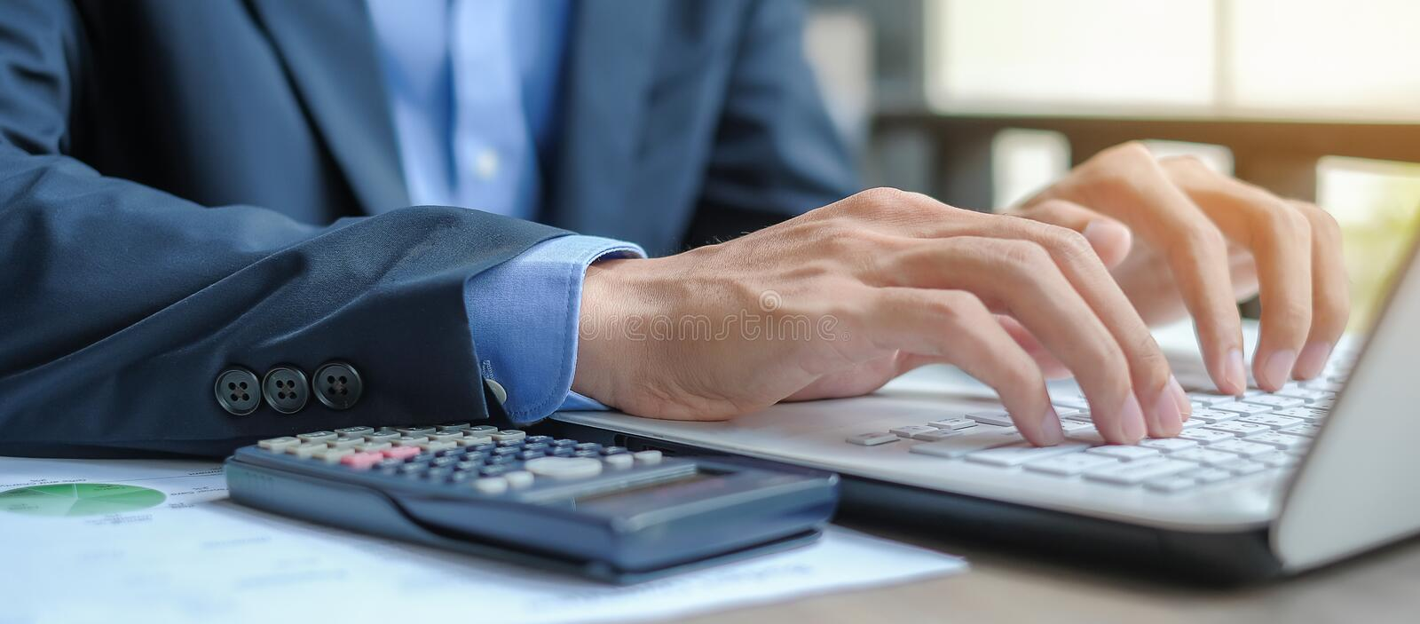 Manager calculate financial report and graph chart royalty free stock photo
