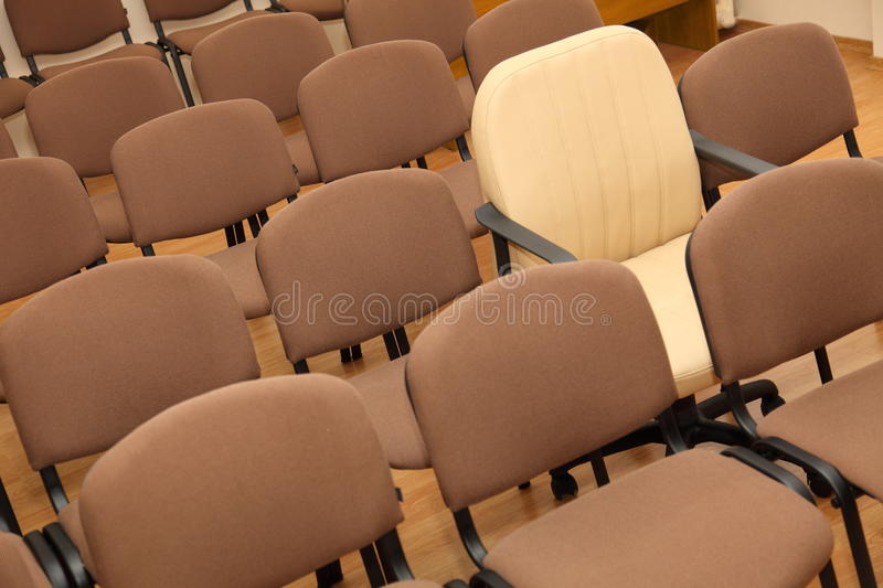 Download Manager Chair Among Ordinary Chairs Stock Photo - Image: 27066368