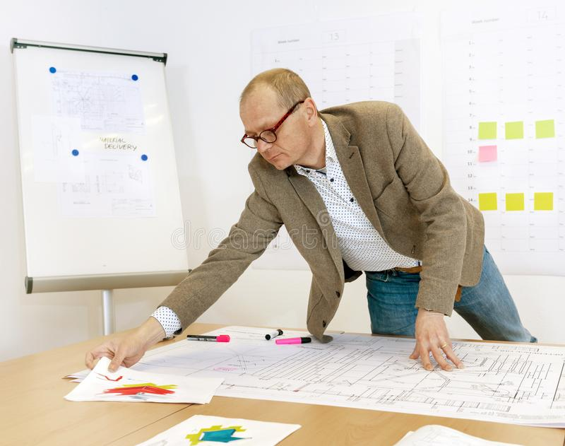 Manager Checking Technical Drawings royalty-vrije stock foto's