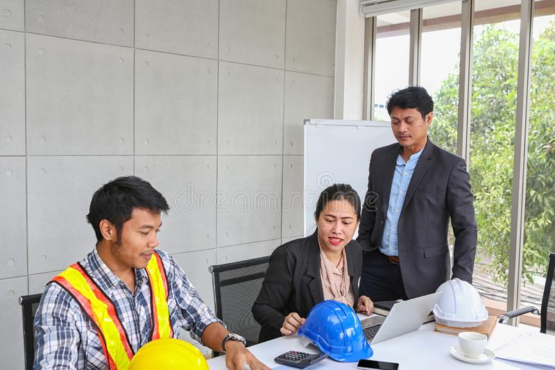 The manager is checking the work of the engineer team. Planning of engineers and technicians. Engineers and Architects Planning royalty free stock photos