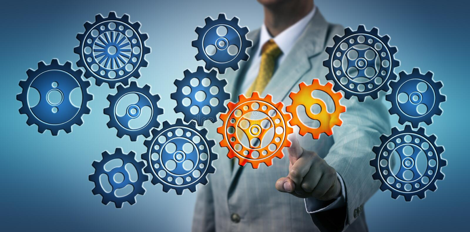 Manager Clicking Two Cogs In Virtual Gear Train royalty free stock photography