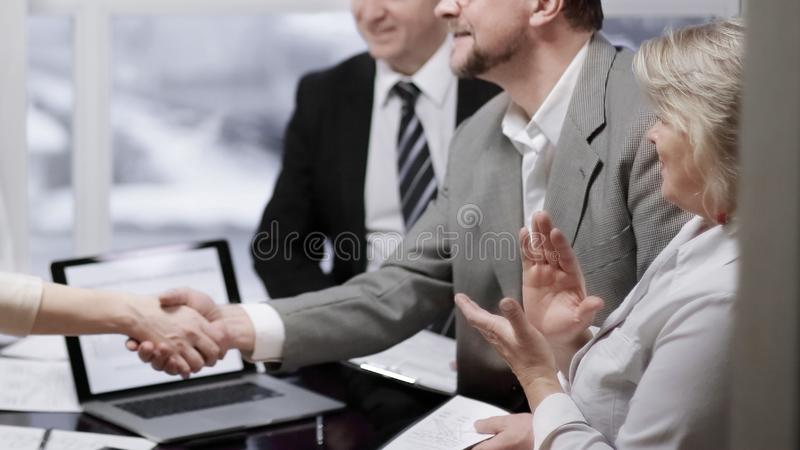 Manager and client shaking hands, making good deal royalty free stock images