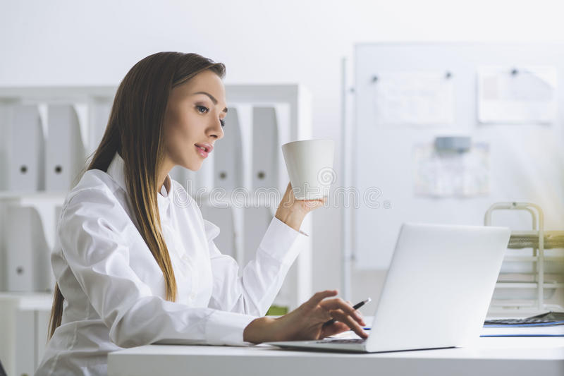 Download Manager With Coffee At Her Workplace Stock Image - Image: 83722727