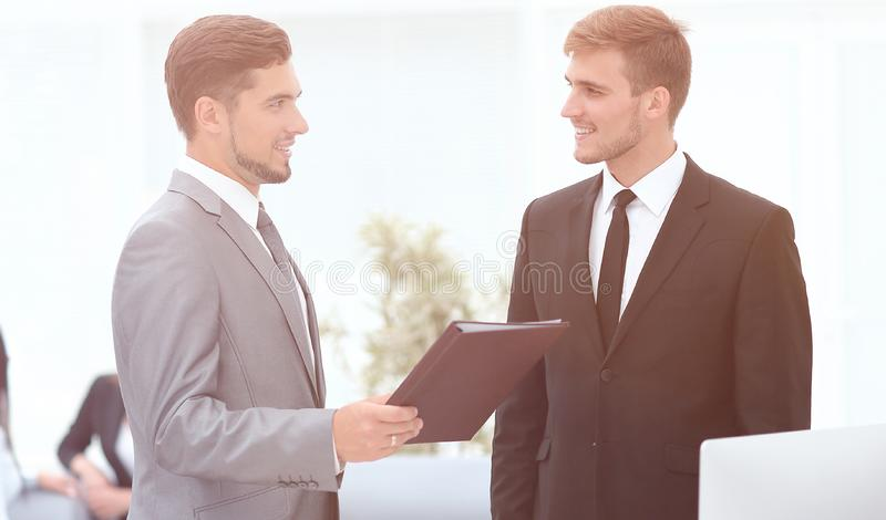 Manager conveys to the employee the documents in the office royalty free stock photo