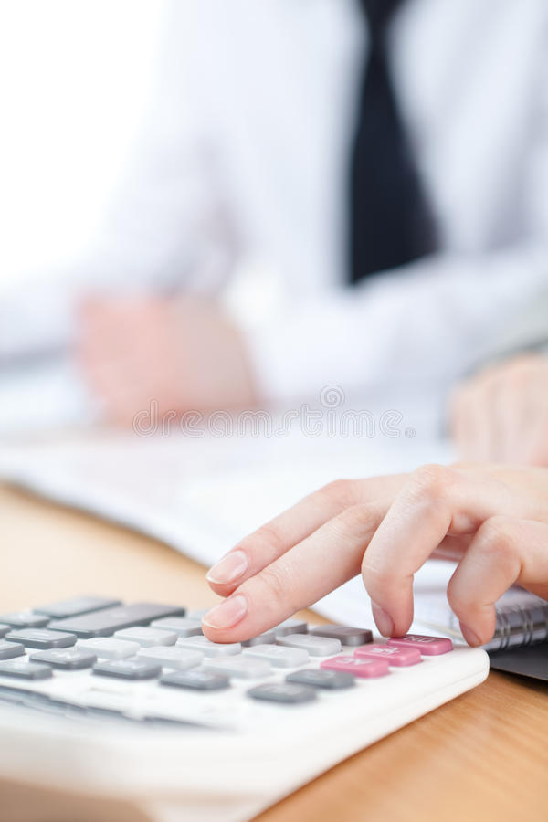 Download Manager Counting On Calculator Stock Image - Image: 26880693