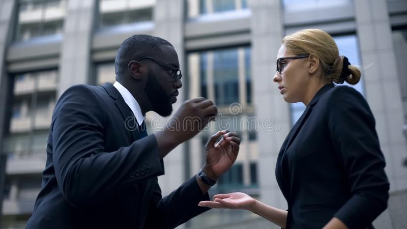 Manager criticizing female employee for mistake at work, stressful job, conflict. Stock photo royalty free stock images