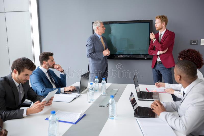 Manager with director discuses about business. On company meeting royalty free stock photos