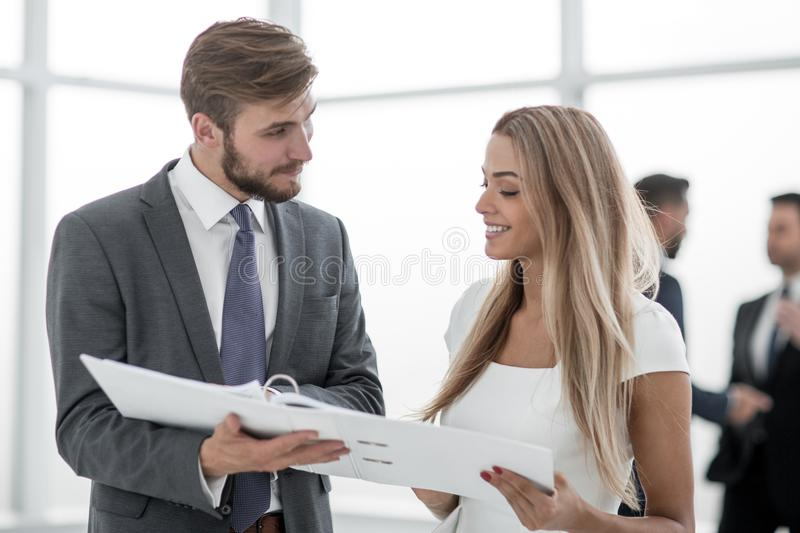 Manager discussing with the client the business document stock image