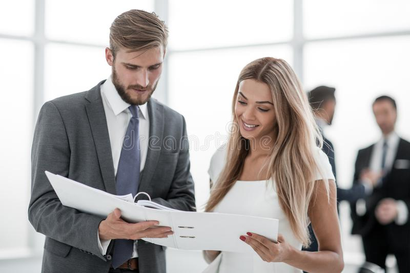 Manager discussing with the client the business document stock images
