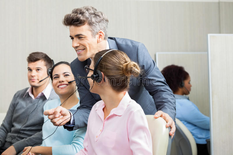 Manager Discussing With Customer Service stock photography