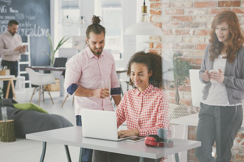 Manager discussing new business plan. Young project manager discussing new business plan with coworkers royalty free stock photos