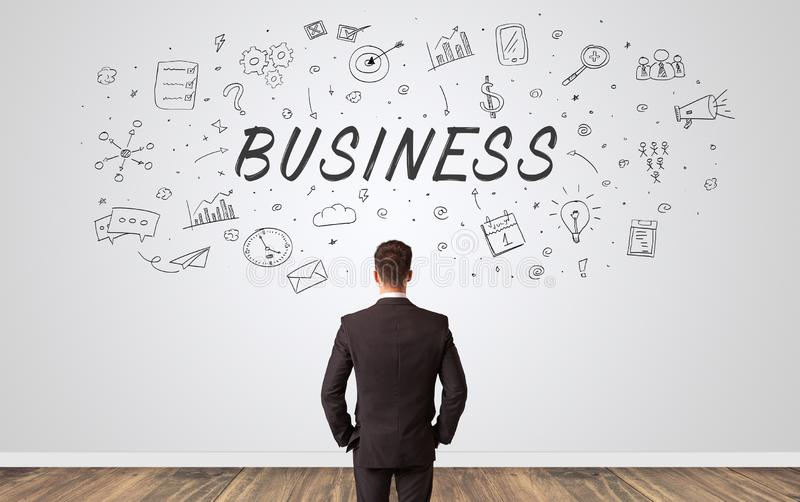 Manager in doubt looking to a wall with business concept royalty free stock images