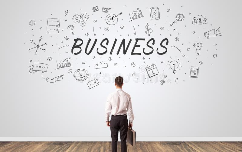 Manager in doubt looking to a wall with business concept stock photos