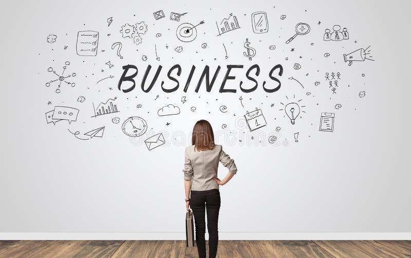 Manager in doubt looking to a wall with business concept stock photography