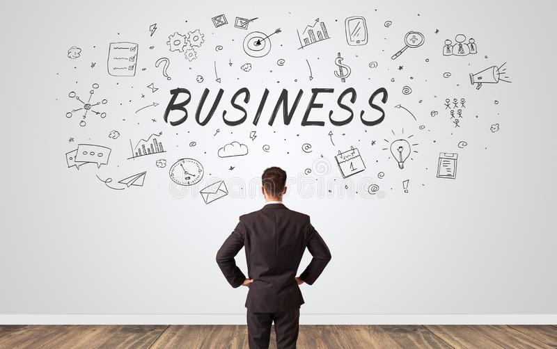 Manager in doubt looking to a wall with business concept stock images