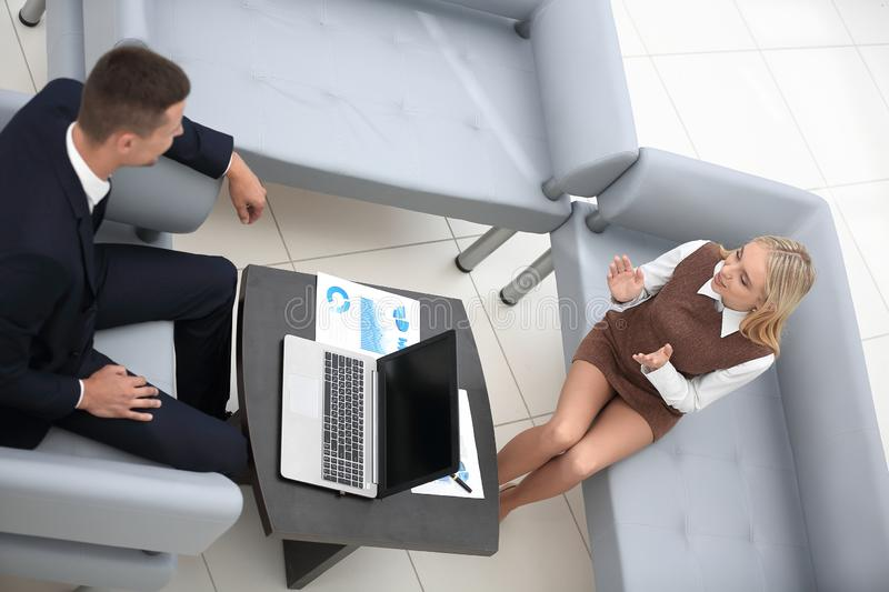 Manager and employee discussing the financial report. stock photography