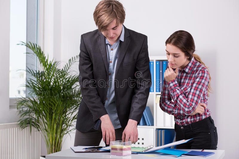 Manager and employee discussing ideas stock image