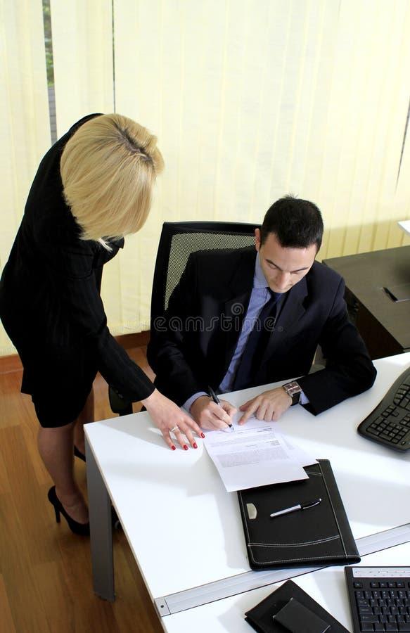 Manager en medewerker stock afbeelding
