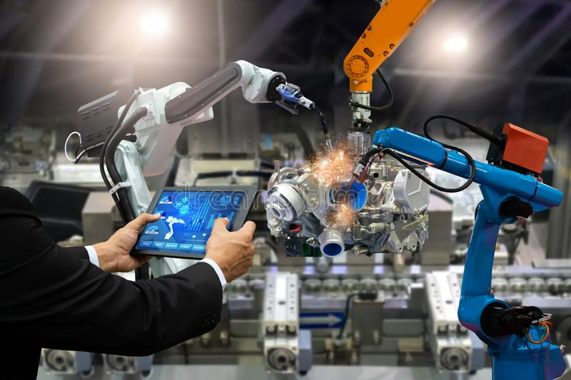 Manager engineer touch screen control automation robot arms the production of factory parts engine manufacturing industry robots a. Nd mechanical arm stock photography