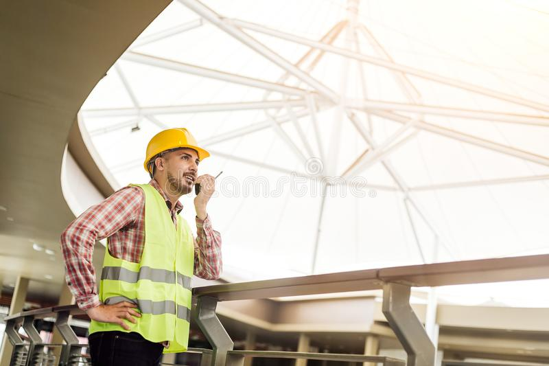 Manager Engineering in standard safety uniform working in construction site. royalty free stock images