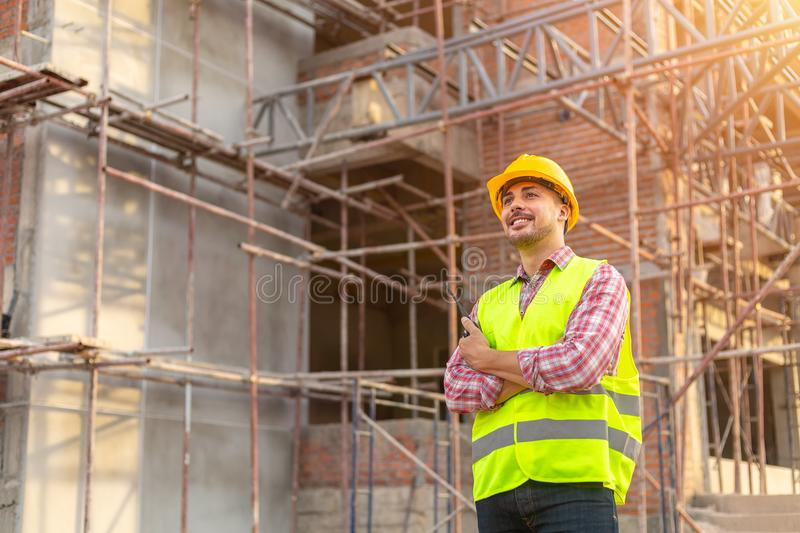 Manager Engineering in standard safety uniform working in a pour stock photography