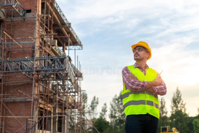 Manager Engineering in standard safety uniform working in a pour royalty free stock images
