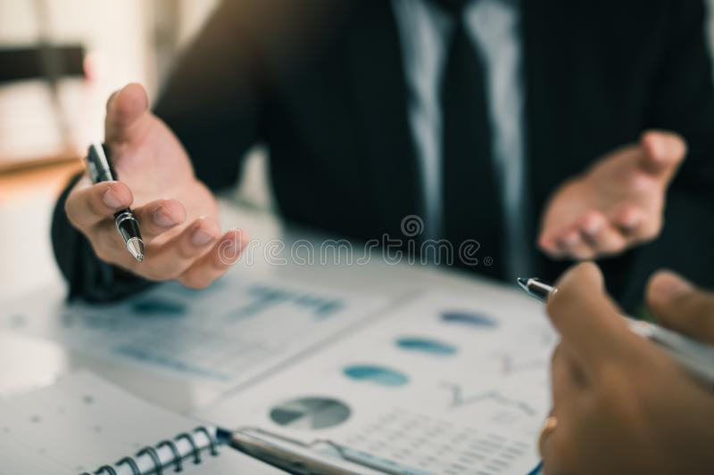 Manager is explaining about the company`s profitability strategy for his employees to listen to at the office.  royalty free stock photos