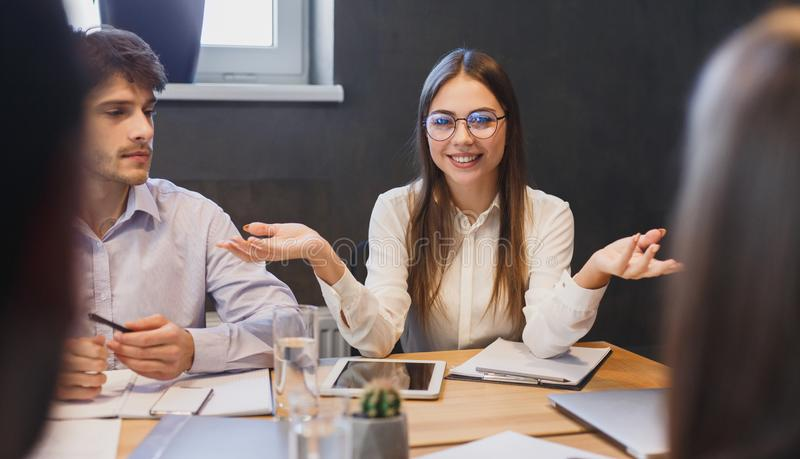 Manager explaining new ideas to colleagues at meeting royalty free stock image