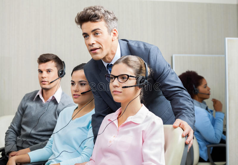 Manager Explaining To Employee In Call Center stock photo