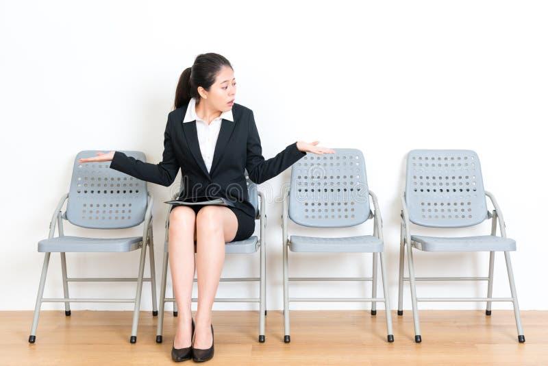 Manager female model sitting on wood floor seat stock image
