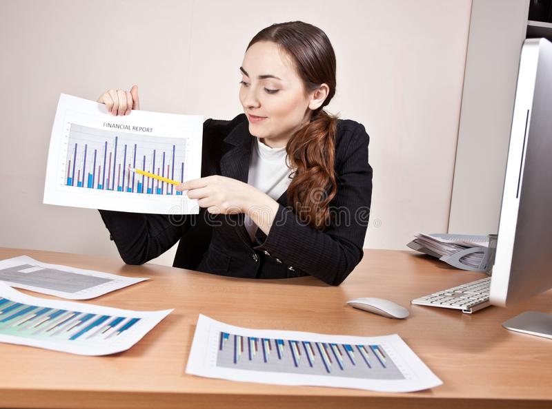 Manager with financial reports at the office royalty free stock photos