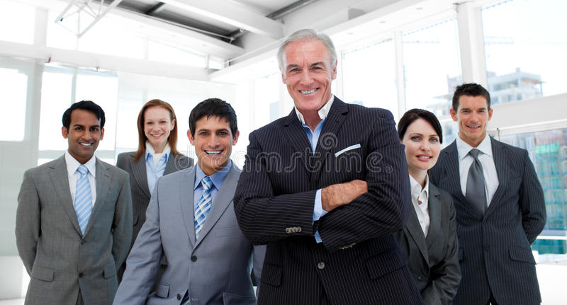 Download Manager With Folded Arms Accompanied By His Team Stock Photos - Image: 12119793