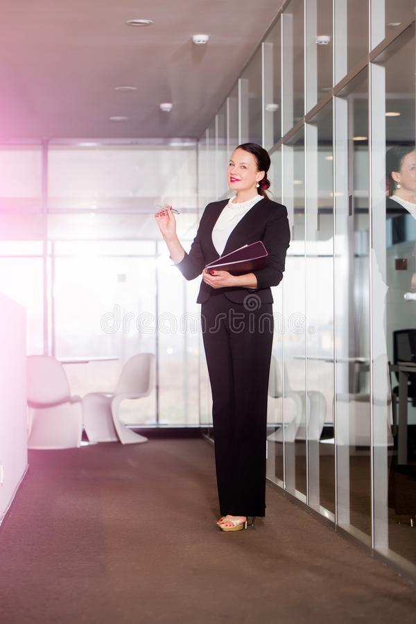Manager girl with happy face hold document. royalty free stock photography