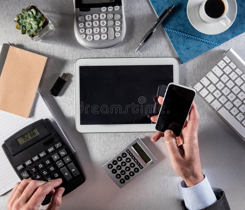 Manager hands counting and multitasking for negotiation with many screens stock photo