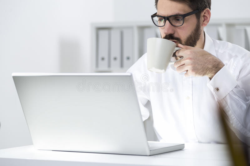 Download Manager Having Coffee In Office Stock Image - Image: 83722123