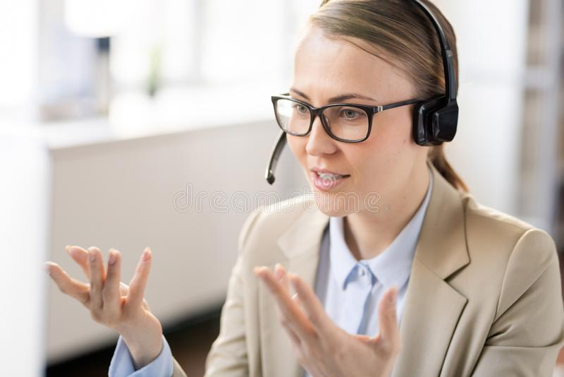 Manager in headset explaining information to client royalty free stock image