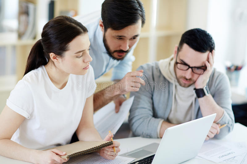 Manager Helping Colleagues with Work royalty free stock image