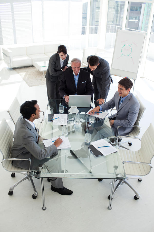 Manager and his colleagues working at a computer stock images