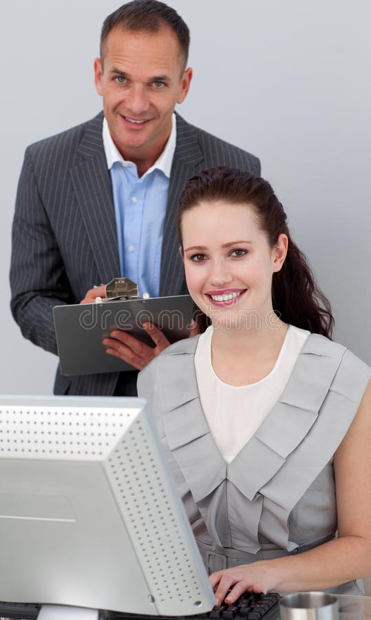 Download Manager And His Employee Smiling At The Camera Stock Images - Image: 12401654