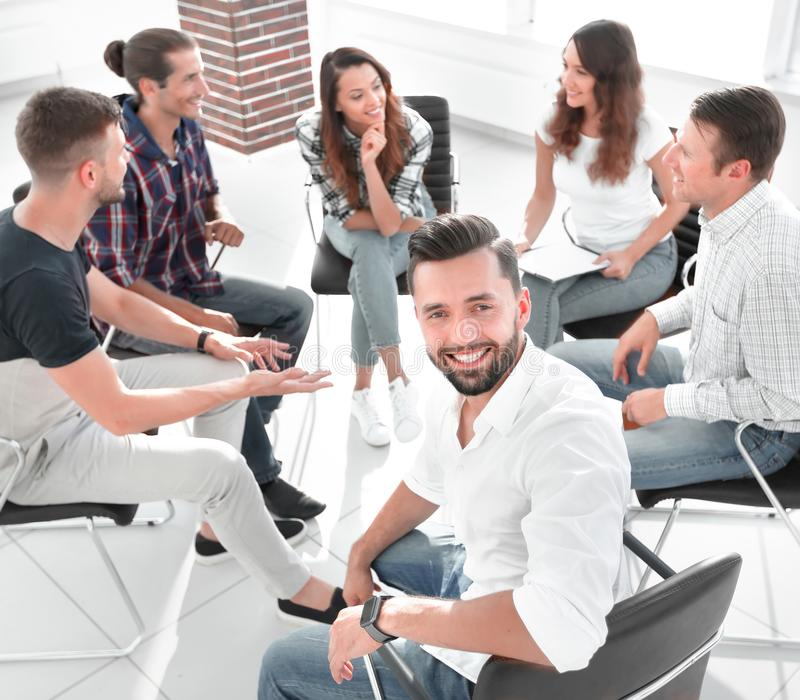 Manager and his team sitting in the office stock image
