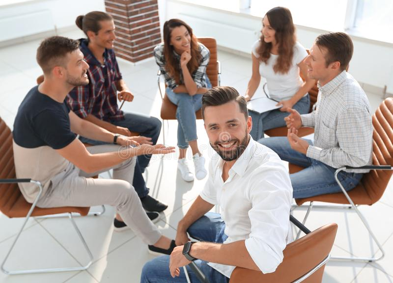 Manager and his team sitting in the office. Successful Manager and his team sitting in the office royalty free stock photography
