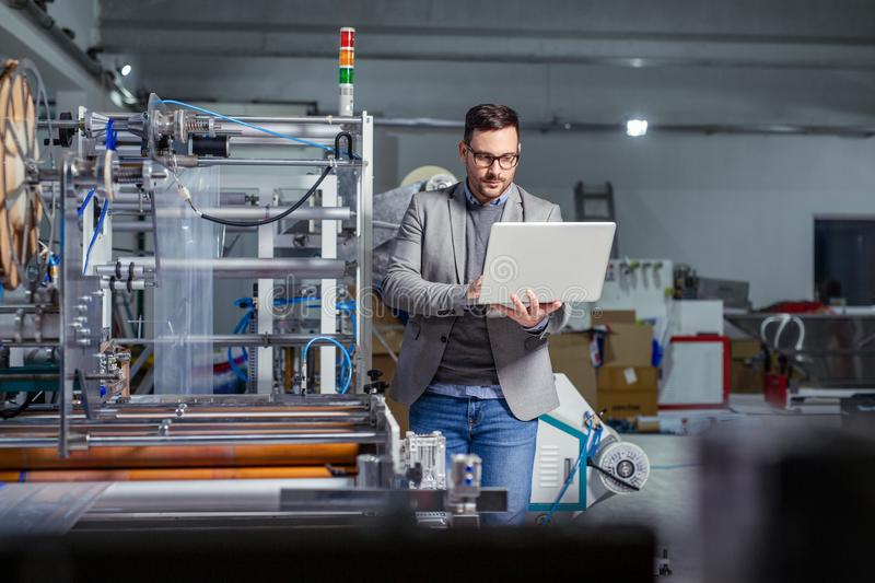 Manager industrial engineer using laptop check and control automation. royalty free stock photo