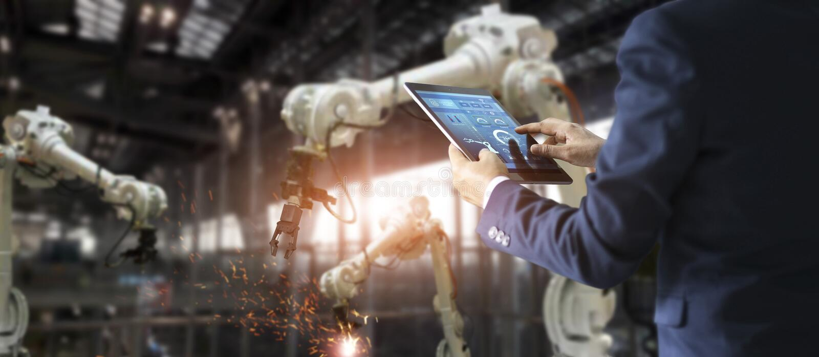 Manager industrial engineer using tablet for checking royalty free stock photography