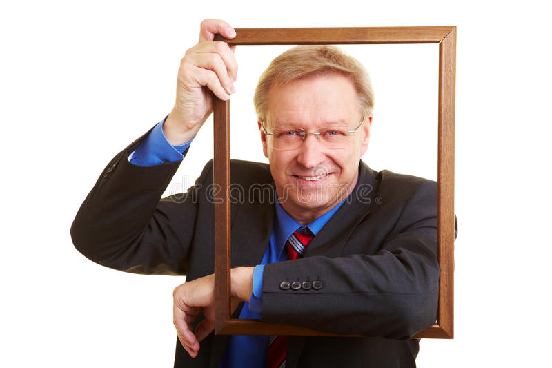 Download Manager leaning in a frame stock image. Image of face - 15444815