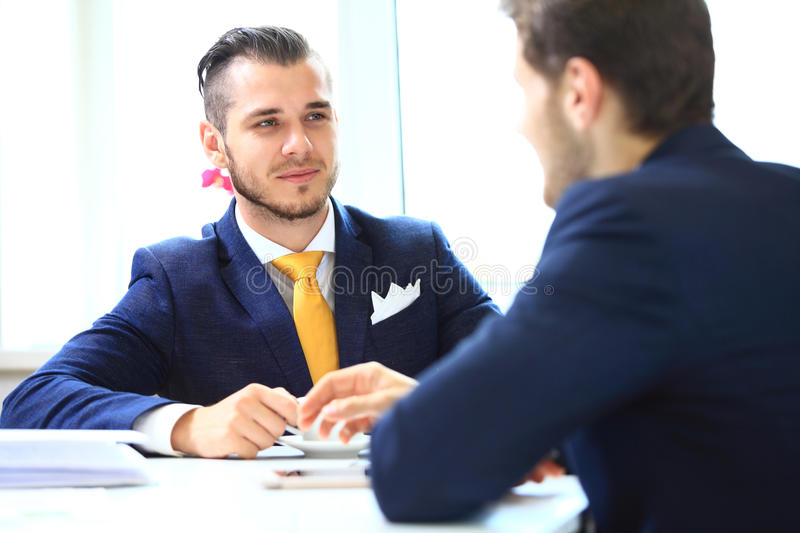 Manager listening to his colleague explanations stock photo