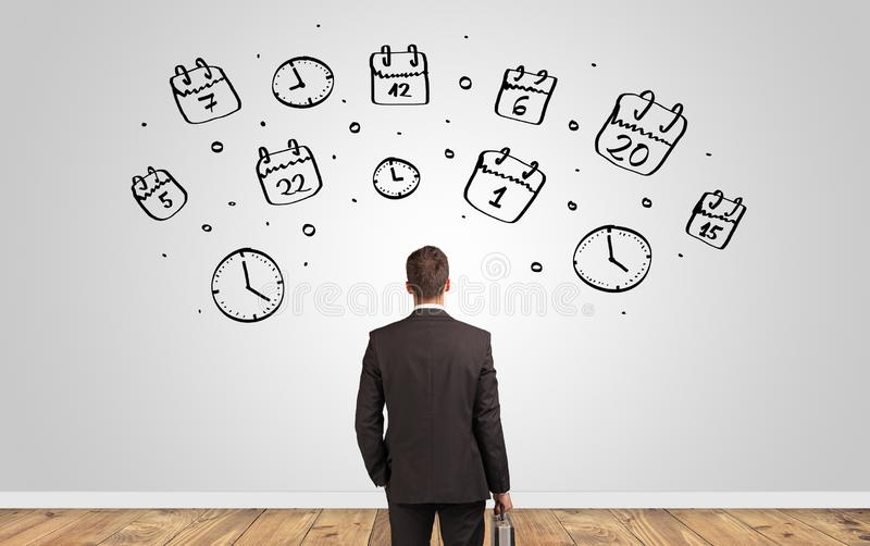 Manager looking to wall with overloaded brain concept stock photos