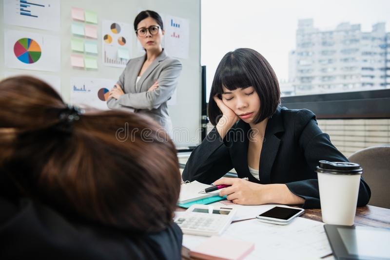 Manager mad at businesswomen sleeping in meeting royalty free stock images