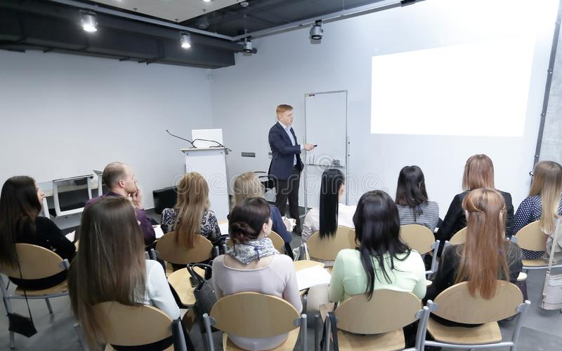 Manager makes a presentation to his business team stock photo
