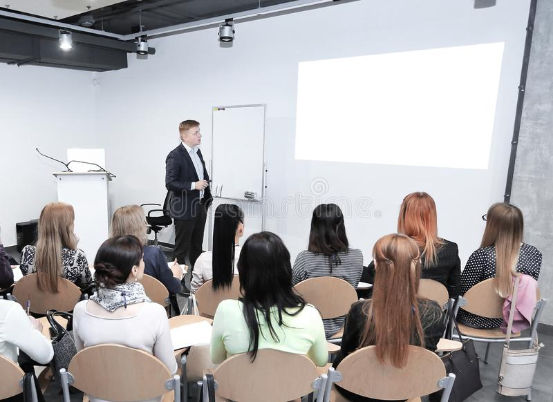 Manager makes a presentation to his business team. Business concept stock image