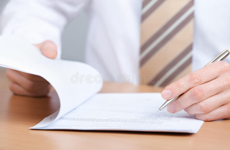 Download Manager Making Notes In The Notebook Stock Photo - Image: 26880714